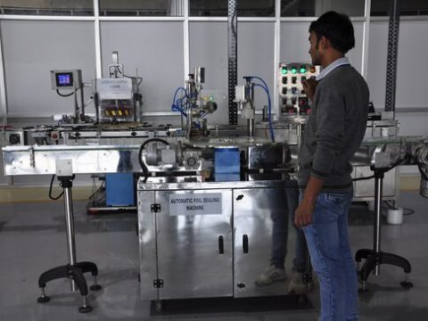 Automatic foil sealing machine in perfume plant